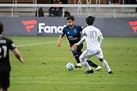 SAN JOSE, CA - NOVEMBER 04: Oswaldo Alanis #4 of the San Jose Earthquakes passes Carlos Vela #10 of the Los Angeles FC during a game between Los Angeles FC and San Jose Earthquakes at Earthquakes Stadium on November 04, 2020 in San Jose, California.