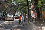 Disinfectant mixed chlorine water is being sprinkled on a road in Lake market area. India is going through a 21 days lockdown for corona virus pandemic. Kolkata, West Bengal, India. Arindam Mukherjee