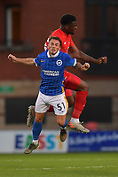 Danny Cashman of Brighton & Hove Albion (U23s) and Shadrach Ogie battle for the ball during the EFL Trophy behind closed doors match between Leyton Orient and Brighton & Hove Albion Under 21s at the Matchroom Stadium, London, England played without supporters able to attend due to ongoing covid-19 government guidelines on 8 September 2020. Photo by Vince  Mignott.