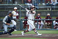 Tanner Thomas (23) of the Virginia Tech Hokies follows through on his swing against the Georgia Tech Yellow Jackets at English Field on April 17, 2021 in Blacksburg, Virginia. (Brian Westerholt/Four Seam Images)