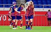 SAITAMA, JAPAN - JULY 24: Lindsey Horan #9  of the United States takes a shot and scores a goal during a game between New Zealand and USWNT at Saitama Stadium on July 24, 2021 in Saitama, Japan.