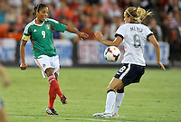 Maribel Dominguez (9) of Mexico goes against USWNT Kristie Mewis (8)  The USWNT defeated Mexico 7-0 during an international friendly, at RFK Stadium, Tuesday September 3 , 2013.