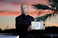 CANNES, FRANCE - JULY 17: Nadav Lapid poses with the 'Jury Prize' Ex-Aequo for 'Ha'berech' during the 74th annual Cannes Film Festival on July 17, 2021 in Cannes, France. <br /> CAP/GOL<br /> ©GOL/Capital Pictures