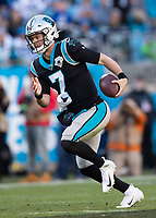 CHARLOTTE, NC - DECEMBER 15: Kyle Allen #7 of the Carolina Panthers runs with the ball during a game between Seattle Seahawks and Carolina Panthers at Bank of America Stadium on December 15, 2019 in Charlotte, North Carolina.