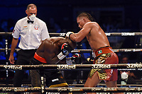 Joe Joyce (red/gold shorts) defeats Carlos Takam during a Boxing Show at the SSE Arena on 24th July 2021