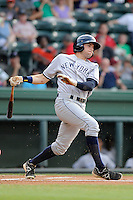 Outfielder Jake Cave (6) of the Charleston RiverDogs bats in a game against the Greenville Drive on Wednesday, June 12, 2013, at Fluor Field at the West End in Greenville, South Carolina. Charleston won, 10-5. The teams wore their Boston and New York affiliate uniforms as part of a promotion. (Tom Priddy/Four Seam Images)