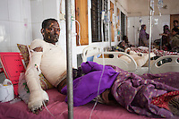 Faruk, 30, one of the victims of petrol bomb attack cries in pain as he receives treatment at the Dhaka Medical College hospital in Dhaka, Bangladesh, March 22, 2015. Ten people, including eight workers, suffered burn injuries in a petrol bomb attack on a sand-laden truck at Moghirdhal on the Magura-Jessore road in Sadar upazila on Saturday night.  As the truck reached Moghirdhal around 8:00pm, miscreants hurled a petrol bomb at the vehicle. Soon after the petrol bomb attack, the truck went up in flames, leaving eight workers and the truck driver and his helper burnt.