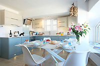 BNPS.co.uk (01202) 558833. <br /> Pic: KnightFrank/BNPS<br /> <br /> Pictured: Kitchen/diner. <br /> <br /> The ultimate room with a view...<br /> <br /> A former fish cellar that is now an idyllic waterfront home overlooking a famous Cornish beach is on the market for £930,000.<br /> <br /> The ground floor apartment is in a prime frontline position with exceptional panoramic views over Porthmeor Beach and out to sea.<br /> <br /> Estate agent Christopher Bailey said the window in the reception space is like having your own live television screen looking out on the action of the beach.<br /> <br /> It has been designed and renovated to an exceptionally high standard and the immaculate flat is currently rented out for short holiday let, making about £40,000 profit a year.