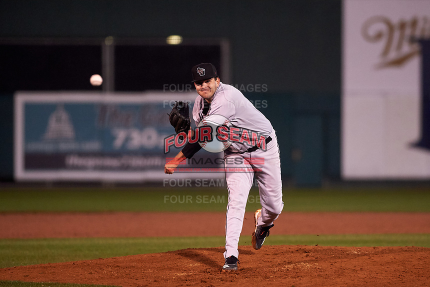 Wisconsin Timber Rattlers relief pitcher Michael Mediavilla (14) during a Midwest League game against the Lansing Lugnuts at Cooley Law School Stadium on May 2, 2019 in Lansing, Michigan. Lansing defeated Wisconsin 10-4. (Zachary Lucy/Four Seam Images)