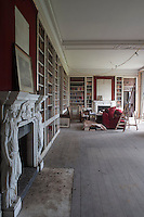 Classical marble fireplaces are a feature of the library which is the first room in the property to be restored