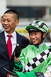 Jockey Dylan Mo Hin-tung, who rode #6 Green Energy, (C) and trainer Danny Shum Chap-shing (L2) pose for photo after winning the race 5 during Hong Kong Racing at Sha Tin Racecourse on October 01, 2018 in Hong Kong, Hong Kong. Photo by Yu Chun Christopher Wong / Power Sport Images