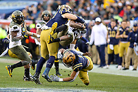 Philadelphia, PA - December 14, 2019:    Army Black Knights quarterback Christian Anderson (13) gets tackled by several Navy Midshipmen defenders during the 120th game between Army vs Navy at Lincoln Financial Field in Philadelphia, PA. (Photo by Elliott Brown/Media Images International)