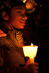 A young girl holds a candle at the vigil with Desmond Tutu at the Bella Center. (Images free for Editorial Web usage for Fresh Air Participants during COP 15. Credit: Robert vanWaarden)