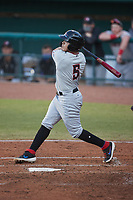 Frainyer Chavez (5) of the Hickory Crawdads follows through on his swing against the Greensboro Grasshoppers at First National Bank Field on May 6, 2021 in Greensboro, North Carolina. (Brian Westerholt/Four Seam Images)