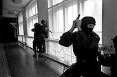 Moscow, Russia .1995.ALEX, a legal security company for anti-terrorist protection. Although the company is legal they will, if necessary, preform a razbourka. They practise protecting an executive from an attack.