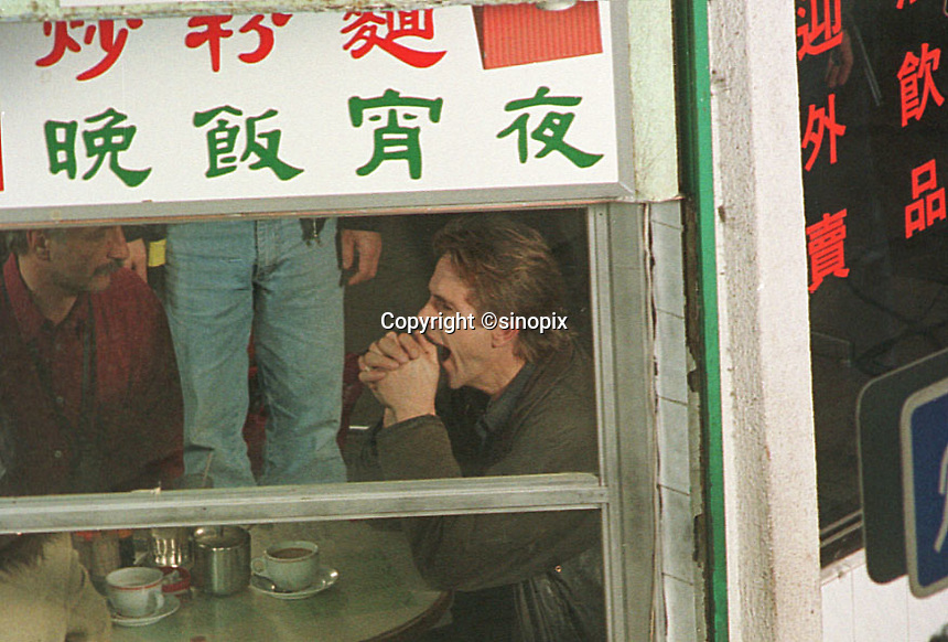Jeremy Irons, an English actor at a local eatery in Hong Kong