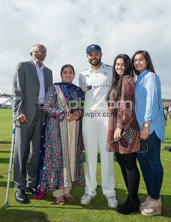 Picture by Allan McKenzie/SWpix.com - 23/08/2016 - Cricket - Specsavers County Championship - Yorkshire County Cricket Club v Nottinghamshire County Cricket Club - North Marine Road, Scarborough, England - Azeem Rafiq with his family after being presented with his Yorkshire county cap.