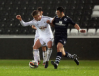 Pictured: Keston Davies of Swansea (L) Monday 30 March 2015<br />
