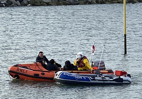 The Howth RNLI inshore boat and the rescued inflatable dinghy
