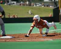 Texas CF Jordan Danks dives back to 1st against Baylor on May 3rd, 2008. Photo by Andrew Woolley / Four Seam Images
