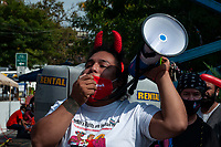 NEW YORK, QUEENS - NY SEPTEMBER 18: A protester chanting slogans on a megaphone and the protesters holding a banner saying sex work is work during the demonstration against discrimination of sex work held on 18 September, 2020 in Jackson Heights,Queens,New York. <br />  (Photo by Joana Toro /VIEWpress)