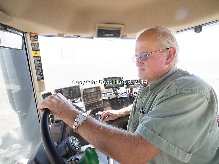 All sorts of technology, including GPS, ;crowds the cabin of Bobby Hutchinson's  state of the art tractor.