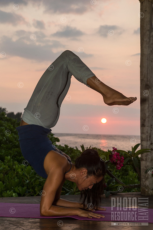 Yoga instructor Miki Sato practices asanas at a beach in Hawai'i.