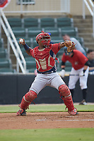 Hagerstown Suns catcher Israel Pineda (20) makes a throw to second base between innings of the game against the Kannapolis Intimidators at Kannapolis Intimidators Stadium on August 27, 2019 in Kannapolis, North Carolina. The Intimidators defeated the Suns 5-4. (Brian Westerholt/Four Seam Images)