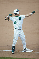 Hunter Baker (45) of the Charlotte 49ers celebrates at third base after hitting a triple against the Appalachian State Mountaineers at Atrium Health Ballpark on March 23, 2021 in Kannapolis, North Carolina. (Brian Westerholt/Four Seam Images)