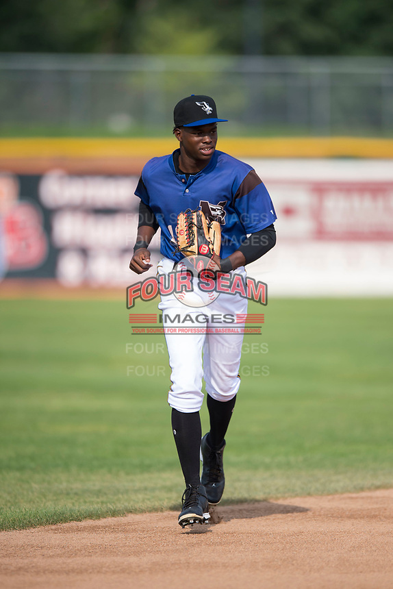 Missoula Osprey center fielder Kristian Robinson (18) jogs off the field between innings of a Pioneer League game against the Orem Owlz at Ogren Park Allegiance Field on August 19, 2018 in Missoula, Montana. The Missoula Osprey defeated the Orem Owlz by a score of 8-0. (Zachary Lucy/Four Seam Images)