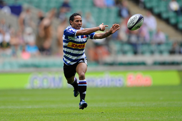 Henry Wolhuter of DHL Western Province passes during the World Club 7s at Twickenham on Saturday 17th August 2013 (Photo by Rob Munro)