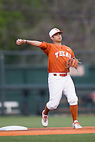 Texas Longhorns shortstop CJ Hinojosa #8 warms up before the NCAA baseball game against the Oklahoma Sooners on April 5, 2013 at UFCU DischFalk Field in Austin Texas. Oklahoma defeated Texas 2-1. (Andrew Woolley/Four Seam Images).