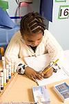 Preschool 3-4 year olds girl writing using left hand