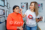 Rasha Amin demonstrating her beauty tips on her daughter Ciara at home in Tralee on Thursday.