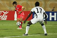South Korea's Ja Cheol Koo (7) makes a goal attempt against Ghana's  John Benson (17) during the FIFA Under 20 World Cup Quarter-final match between Ghana and South Korea at the Mubarak Stadium  in Suez, Egypt, on October 09, 2009.
