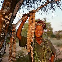 San bushwoman with gourds used in a trance dance, Ghansi, central Kalahari desert 1998