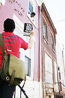 Chris Follmer, ACORN volunteer, goes door to door in North Philadelphia, PA on October 30, 2004 to remind registered voters to turn out for the upcoming election day.