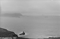 """View towards the Blasket Islands from Dunquin (in Gaelic, Dún Chaoin, meaning """"Caon's stronghold""""), on the tip of the Dingle Peninsula, County Kerry, Ireland.  1971."""