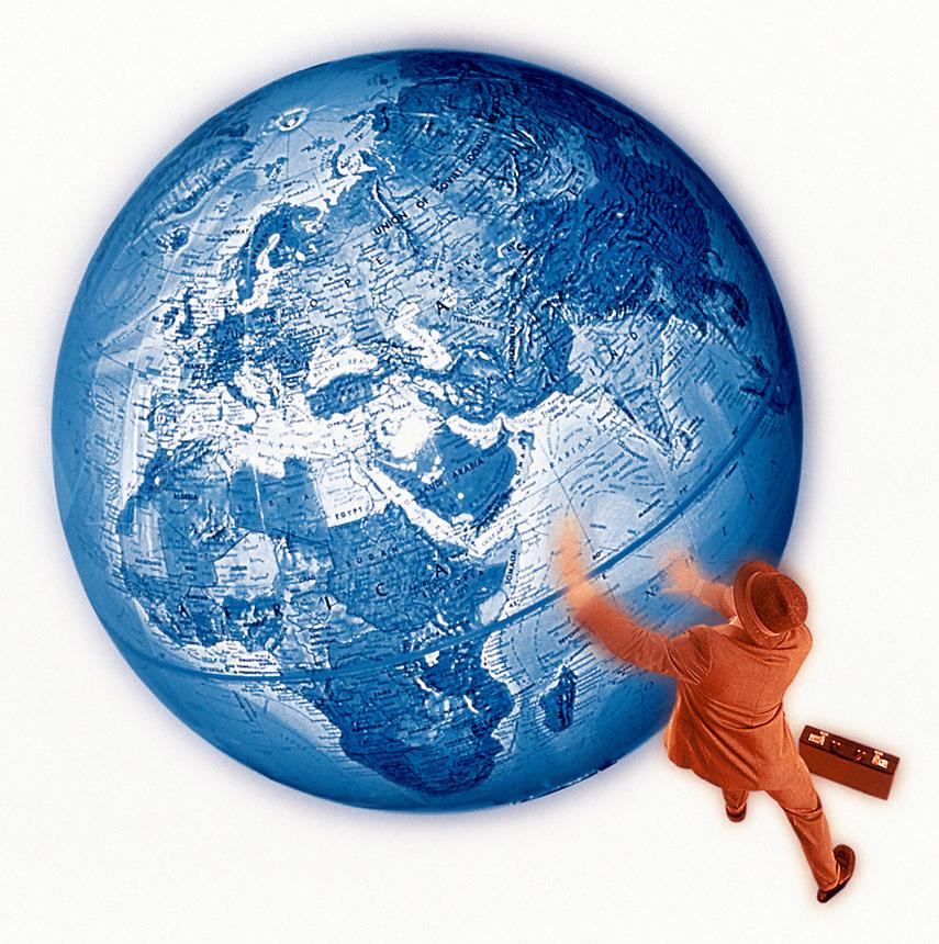 Businessman pushing globe.