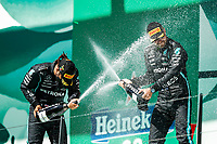 HAMILTON Lewis (gbr), Mercedes AMG F1 GP W12 E Performance, portrait celebrating his victory at the podium with BOTTAS Valtteri (fin), Mercedes AMG F1 GP W12 E Performance, portrait during the Formula 1 Heineken Grande Prémio de Portugal 2021 from April 30 to May 2, 2021 on the Algarve International Circuit, in Portimao, Portugal <br /> FORMULA 1 : Grand Prix Portugal - Essais - Portimao - 02/05/2021 <br /> Photo DPPI/Panoramic/Insidefoto <br /> ITALY ONLY
