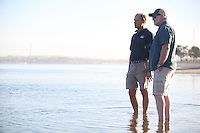 San Diego CA, USA.  7th, December 2015:  Michael Shane (L) of Hubbs Sea World Research Institute and Mission Bay High School Biology Teacher, Steve Walters look on as students from Misson Bay High release juvenile white sea bass into Mission Bay at Crwon Point.  Mission Bay High School is one of the first schools in the state to participate in the Seabass in the Classroom Project, which is a collaboration between Hubbs-Sea World Research Institute and the California Department of Fish and Game.