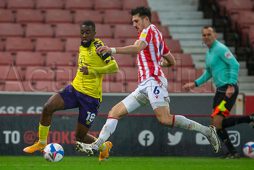 21st November 2020; Bet365 Stadium, Stoke, Staffordshire, England; English Football League Championship Football, Stoke City versus Huddersfield Town; sIsaac Mbenza of Huddersfield Town is tackled by Danny Batth of Stoke City