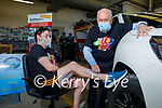 A very worried Tommy Hayes about to get his leg waxed by Tom O'Connor in Kellihers Garage for their Comfort for Chemo and Recovery Haven fundraiser on Friday