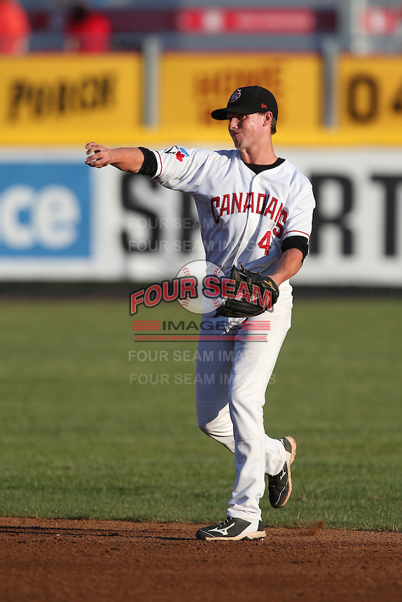 Lane Thomas (4) of the Vancouver Canadians makes a throw during a game against the Tri-City Dust Devils at Nat Bailey Stadium on July 23, 2015 in Vancouver, British Columbia. Tri-City defeated Vancouver, 6-4. (Larry Goren/Four Seam Images)