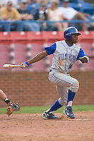 Derrick Robinson #11 of the Wilmington Blue Rocks follows through on his swing versus the Winston-Salem Dash at Wake Forest Baseball Stadium June 14, 2009 in Winston-Salem, North Carolina. (Photo by Brian Westerholt / Four Seam Images)