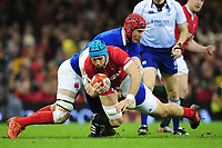 Justin Tipuric of Wales is tackled by Bernard Le Roux of France during the Guinness Six Nations Championship Round 3 match between Wales and France at the Principality Stadium in Cardiff, Wales, UK. Saturday 22 February 2020