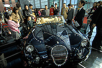 "The xxxxx sports car for sale at the ""Top Show"" luxury gods fair in Shenzhen, China."