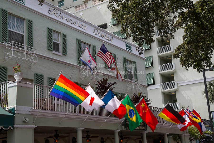 Ft. Lauderdale, Florida.  Riverside Hotel and Flags, including Gay Pride Flag.  E. Las Olas Blvd.