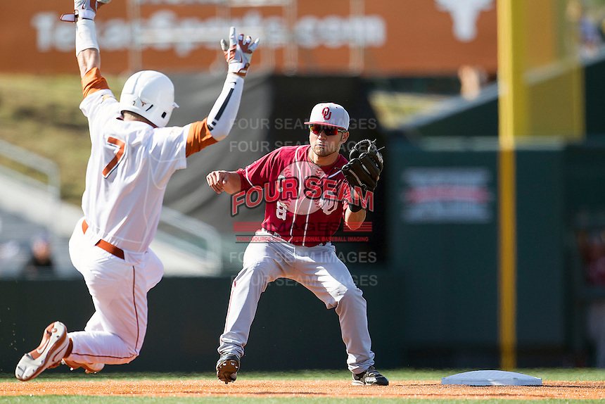 Oklahoma Sooners shortstop Jack Mayfield #8 tags Texas Longhorns baserunner Weston Hall #7 as he slides into second base during an attempted steal in the NCAA baseball game on April 6, 2013 at UFCU DischFalk Field in Austin, Texas. The Longhorns defeated the rival Sooners 1-0. (Andrew Woolley/Four Seam Images).