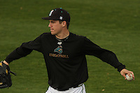 Matt Rein #18 of the Coastal Carolina University Chanticleers throwing in the outfield before a game against  the University of San Diego Toreros  at Watson Stadium at Vrooman Field in Conway,, SC on March 26, 2010. Photo by Robert Gurganus/Four Seam Images